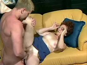 Dissolute mature is drilled on sofa