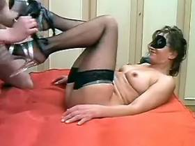 Masked mature slut in fishnet stockings fucking on bed
