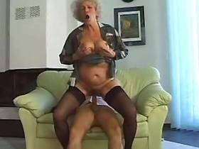 Dirty old fart comes hard riding young dick on couch