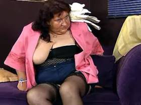 Fat old nymphomaniac fucks herself with dildo on sofa