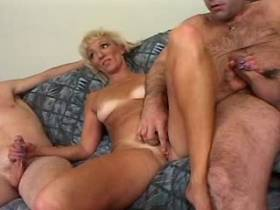 Two men sharing hot blonde mature in cool gangbang