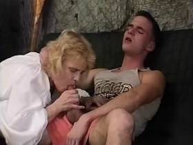 Aged blonde mature gives blow job to young guy