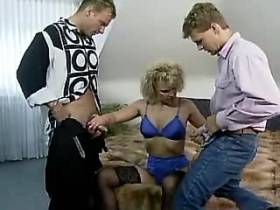 Mature lady sucking cocks and fucking with two guys