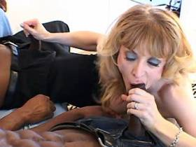 Lewd milf fucking with two big blacky guys in orgy