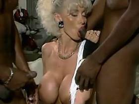 Blonde milf sucks out cum from two big black cocks