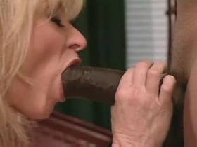 Mature sucks big black cock and gets licking pussy