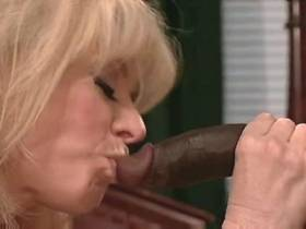 Blonde mature gets cumshot on ass from black cock