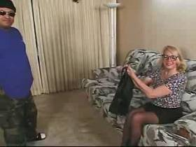 Blond mature gets oral and fucks with fat man on sofa