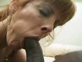 Redhead mature sucks big black cock and gets facial